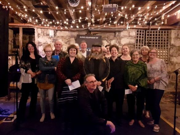 A contingent of Weathering the Future writers at November's Words Out Loud.