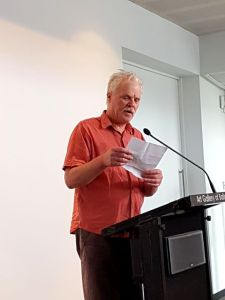 Fraser Mackay reads during the launch of Weathering the Future.